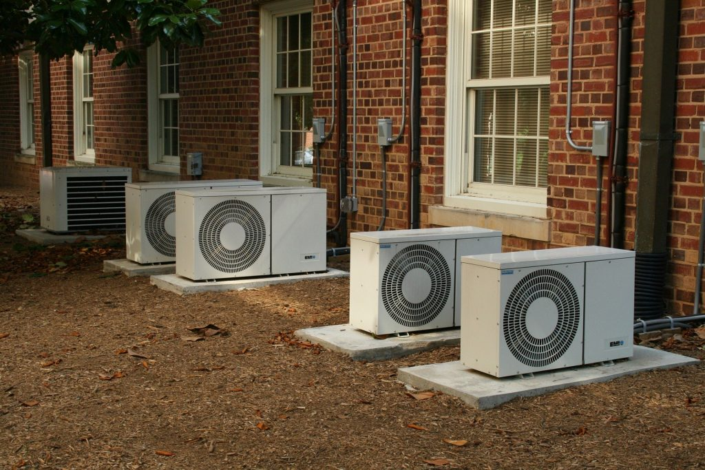 "A row of mini split air conditioners used to represent the concept ""how to hide your air conditioner unit."""