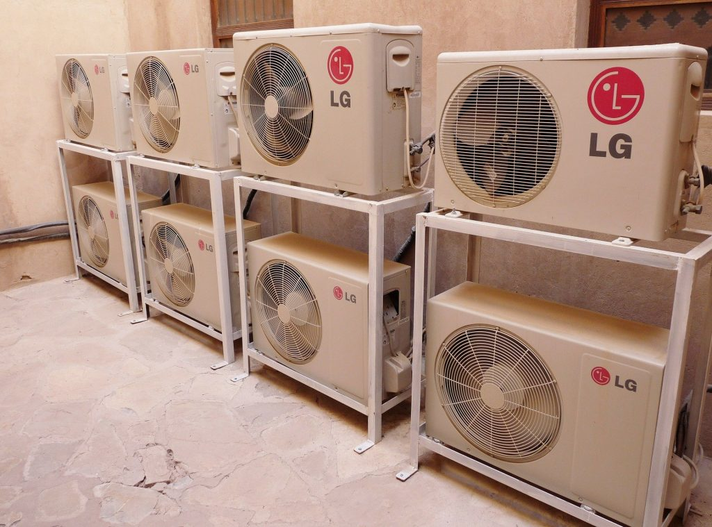 "A row of air conditioners used to demonstrate the concept ""how often should I have my air conditioner serviced?"""
