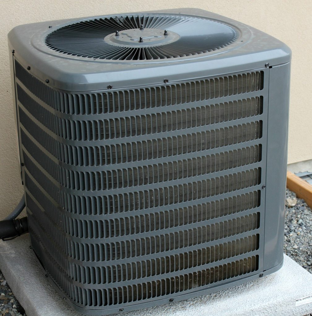 "A central air conditioner used to display the concept of ""air conditioner cover."""