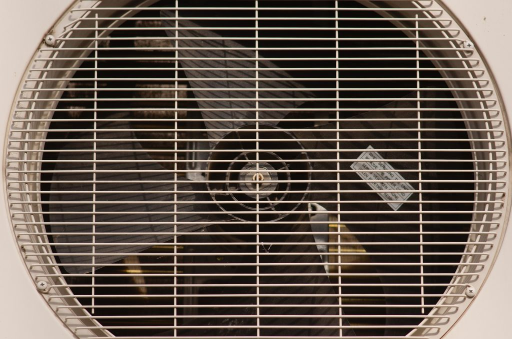 """An air conditioner closeup used to represent the concept of """"will a dirty filter keep an AC from cooling?"""""""